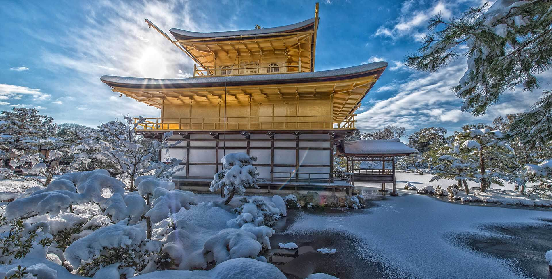 The snow in winter of Golden Pavilion Temple in Kyoto, Japan. The temperature in cold winter will drop to -10 degree and reach to 40 degree hot in the summer.