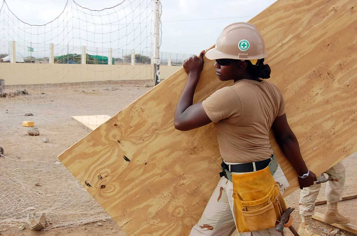 Female workers are carrying spruce splints