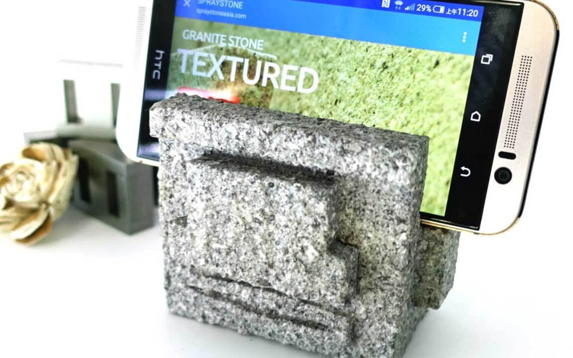 The styrofoam and plastic phone holder, which covered with ADD STONE imitation stone paint, became a granite texture stone carving phone holder.