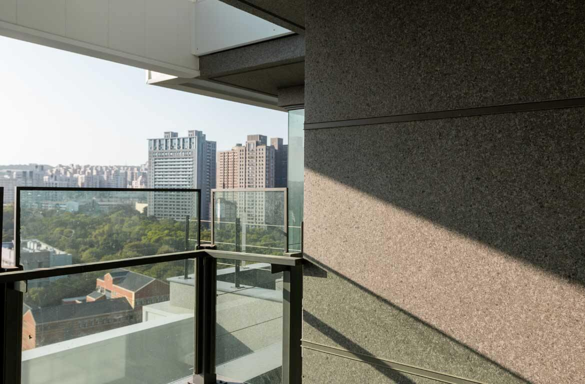 Look out from the higher floor, the scene and campus are visible. The warm sunshine reflected on the granite texture wall with ADD STONE Granite Texture Faux-Stone coating